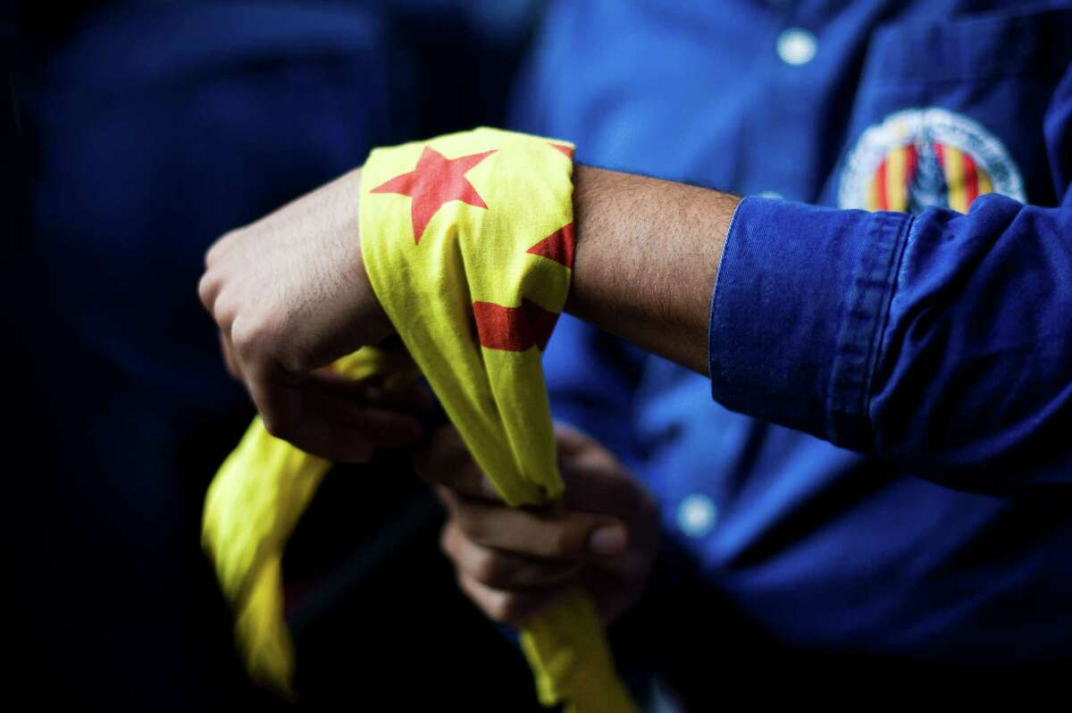 A member of the Colla 'Capgrossos de Mataro' ties a headscarf around his wrist during the 24th Tarragona Castells Competition on October 7, 2012 in Tarragona, Spain.