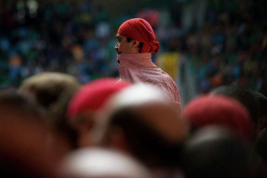 A member of the Colla 'Xiquets de Tarragona' looks on before building a human tower during the 24th Tarragona Castells Competition on October 7, 2012 in Tarragona, Spain. Photo: David Ramos, Getty Images / 2012 Getty Images