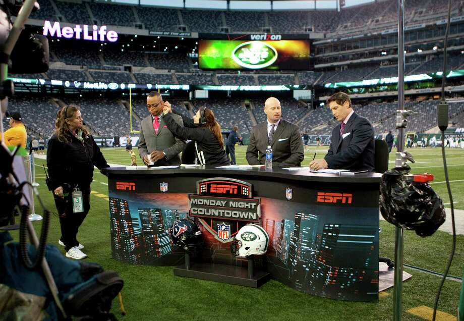 ESPN's Stewart Scott, left, Trent Dilfer and Steve Young prepare for the Monday Night Countdown broadcast before the Houston Texans game against the New York Jets at MetLife Stadium on Monday, Oct. 8, 2012, in East Rutherford. Photo: Smiley N. Pool, Houston Chronicle / © 2012  Houston Chronicle