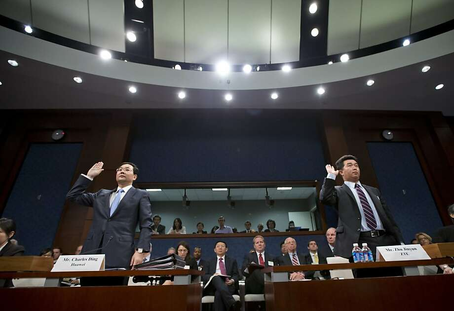 Charles Ding (left) and Zhu Jinyun, executives of two Chinese technology companies, appear before the House Intelligence Committee last month. Photo: J. Scott Applewhite, Associated Press