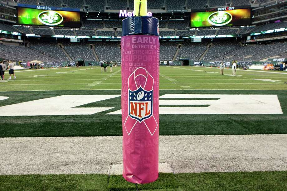 The goal post pad are adorned in pink for breast cancer awareness  before the Houston Texans game against the New York Jets at MetLife Stadium on Monday, Oct. 8, 2012, in East Rutherford. Photo: Smiley N. Pool, Houston Chronicle / © 2012  Houston Chronicle