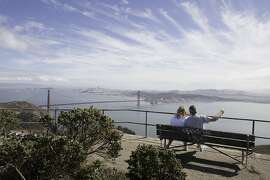 Visitors to Hawk Hill in the Marin Headlands sit to enjoy the view of San Francisco, CA on Friday, October, 5, 2012.
