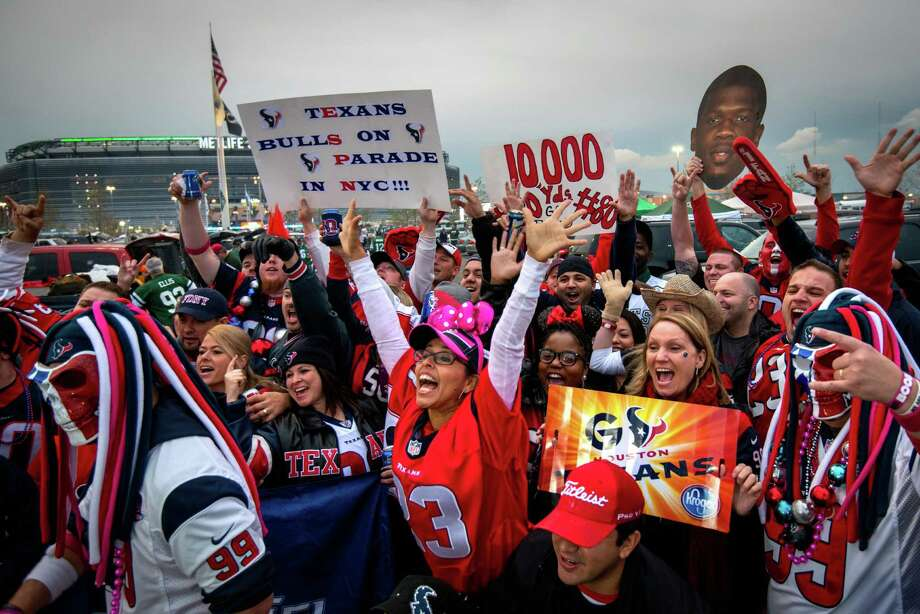 Houston Texans fans whoop it up in the parking lot while tailgating before the Texans game against the New York Jets on Monday Night Football at MetLife Stadium on Monday, Oct. 8, 2012, in East Rutherford. Photo: Smiley N. Pool, Houston Chronicle / © 2012  Houston Chronicle