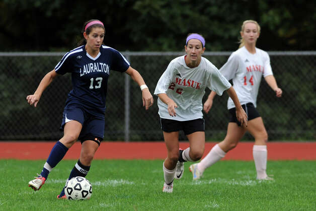 Lauralton Hall's Alyssa Fratarlangeli and Masuk's Diana Antenucci during high school soccer action in Monroe, Conn. Oct. 8th, 2012. Photo: Ned Gerard / Connecticut Post