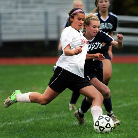 Masuk's Nicole Yanouzas fights for the ball against Lauralton Hall's Morgan Quinn during a high school soccer game in Monroe, Conn. Oct. 8th, 2012. Photo: Ned Gerard / Connecticut Post