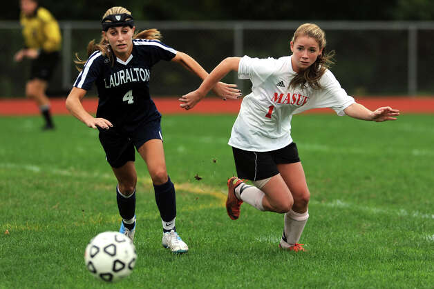 Lauralton Hall's Maggie Salandra fights for the ball with Masuk's Jamie Madden during a high school soccer game in Monroe, Conn. Oct. 8th, 2012. Photo: Ned Gerard / Connecticut Post