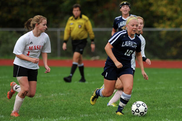Lauralton Hall's Alison Miles in action against Masuk during a high school soccer game in Monroe, Conn. Oct. 8th, 2012. Photo: Ned Gerard / Connecticut Post