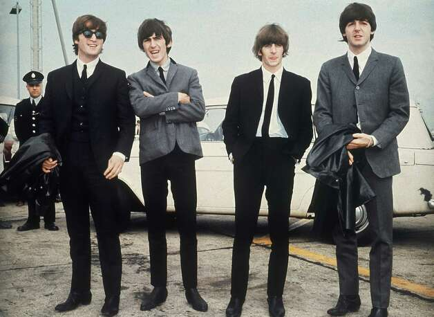 The Beatles, from left, John Lennon, George Harrison, Ringo Starr and Paul McCartney leave London airport in 1964. Photo: ASSOCIATED PRESS / Associated Press 1964 file photo