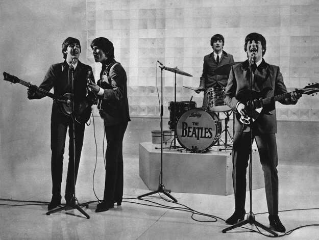 The Beatles are seen performing, date unknown.  From left to right:  Paul McCartney, George Harrison, Ringo Starr, and John Lennon. Photo: AP
