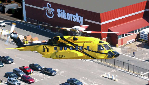 A Sikorsky S-92 helicopter makes a pass over Sikorsky Aircraft plant in Stratford, Conn. in this file photo. Bond Aerospace took delivery of two S-92s that will be fully outfitted to carry workers to rigs in the North Sea.  (PRNewsFoto) Photo: Contributed Photo / Connecticut Post Contributed