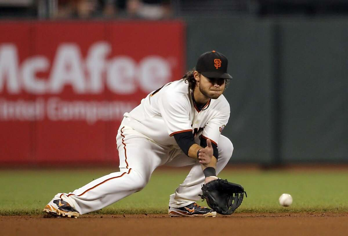 Brandon Crawford fields a ball hit by Paul Goldschmidt during the game against the Diamondbacks on Wednesday. The San Francisco Giants played the Arizona Diamondbacks at AT&T Park in San Francisco, Calif., on Wednesday, September 26, 2012, defeating the Diamondbacks 6-0