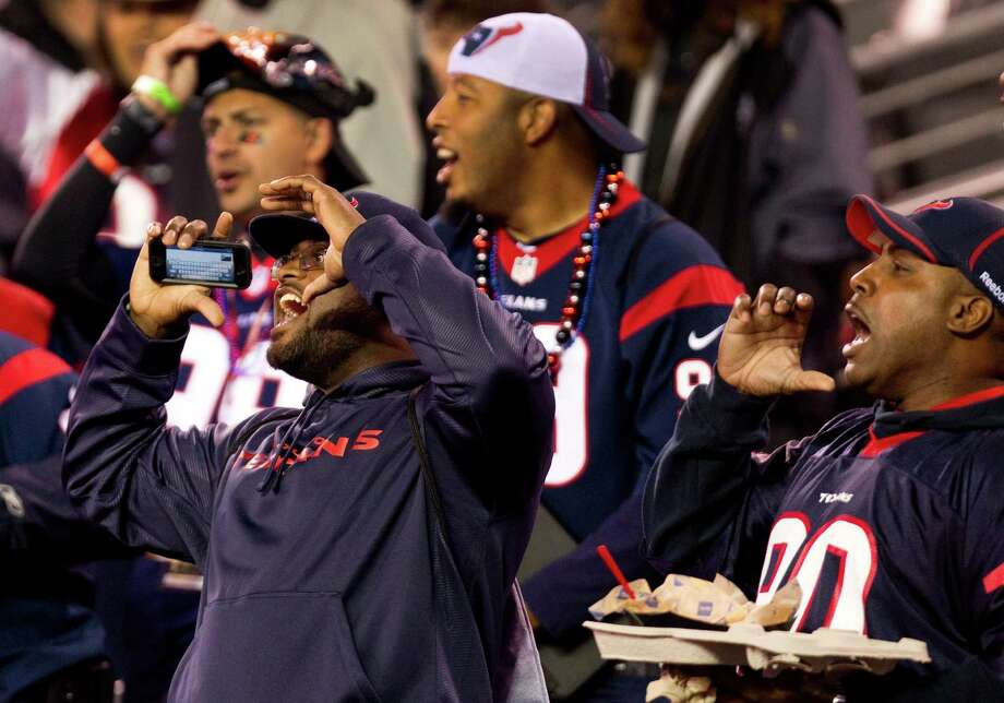 Houston Texans fans cheers as they arrive in the stadium before the Texans' Monday Night Football game against the New York Jets at MetLife Stadium on Monday, Oct. 8, 2012, in East Rutherford, N.J. Photo: Brett Coomer, Houston Chronicle / © 2012  Houston Chronicle