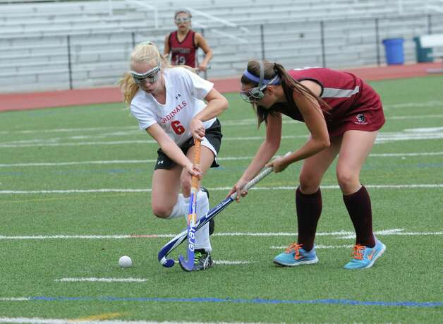 Greenwich High School's # 6 Emma Montgomery fights with Pomperaug High School' s #6, Alyssa Vagnini in a game of field hockey in Greenwich, Monday, Oct. 8, 2012. Greenwich won 5 to 1. Photo: Helen Neafsey / Greenwich Time