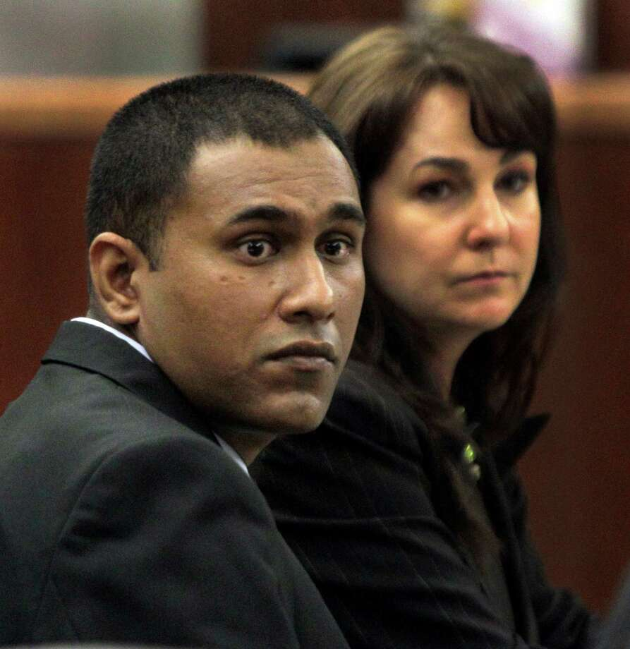 Former Houston Police Dept. officer Abraham Joseph with his attroney Nicole DeBorde in court during his sexual assault trial   Tuesday, Sept. 4, 2012, at the Harris County Criminal Courthouse. He is accused of kidnapping a waitress from outside a restaurant, driving her to an unlighted area and raping her on the trunk of his police car.  ( Melissa Phillip / Houston Chronicle ) Photo: Melissa Phillip / © 2012 Houston Chronicle