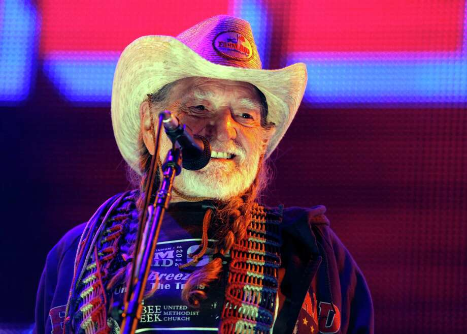 "Willie Nelson, who's due to release his book ""Roll Me Up And Smoke Me When I die"" on Nov. 13, plays John T. Floore Country Store. AP photo Photo: Jacqueline Larma, Associated Press / AP"