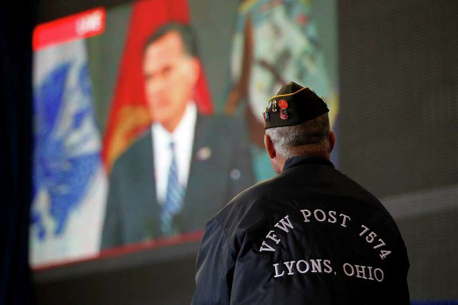 Vietnam veteran David Snyder of Metamora, Ohio, watches a live video broadcast of Republican presidential candidate, former Massachusetts Gov. Mitt Romney, at a campaign event with Republican vice presidential candidate, Rep. Paul Ryan, R-Wis., Monday, Oct. 8, 2012, in Swanton, Ohio.  (AP Photo/Mary Altaffer) Photo: Mary Altaffer / AP