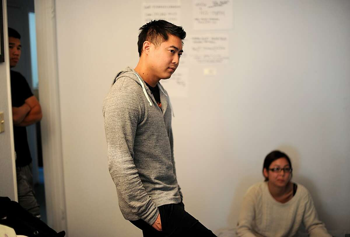 Simon Ko and Sophia Ko, right, discuss their mother's murder on Monday, Oct. 8, 2012, in Hercules, Calif. A neighbor found Susie Ko stabbed to death inside her Hercules home Friday night.