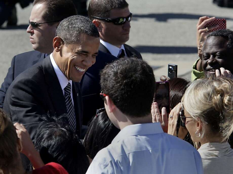 President Obama laughed as he thanked supporters at the airport. President Obama landed at San Francisco International Airport Monday October 8, 2012 on a campaign, fundraising trip to the Bay Area. Photo: Brant Ward, The Chronicle