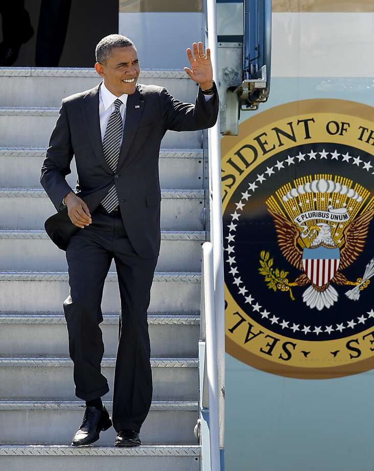 President Obama waved to a small crowd as he walked down the stairs from Air Force One. President Obama landed at San Francisco International Airport Monday October 8, 2012 on a campaign, fundraising trip to the Bay Area. Photo: Brant Ward, The Chronicle