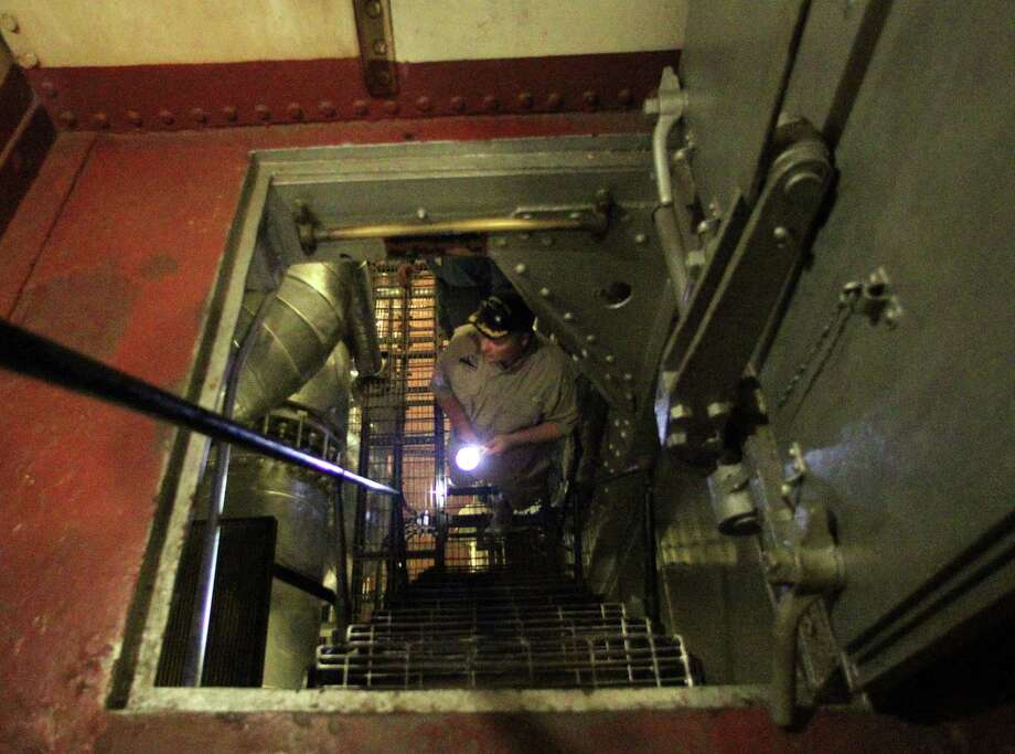 "Battleship Texas, Overnight Education Program Manager Paul McCann climbs a stairway in an area visited during the Battleship Texas ""Hard Hat Tour"" Friday, Oct. 5, 2012, in La Porte. Photo: James Nielsen, Chronicle / © Houston Chronicle 2012"