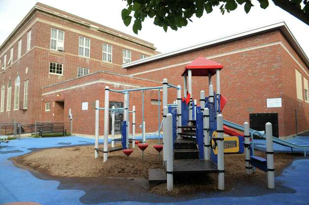 A view the playground at the Lake Avenue Elementary School on Monday, Oct. 8, 2012 in Saratoga Springs, NY.  A group of city residents are trying to convince the school district to leave the playground open in the winter. School officials closed the playground last year amid concerns a child could be hurt hitting the ground after riding a slide.     (Paul Buckowski / Times Union) Photo: Paul Buckowski
