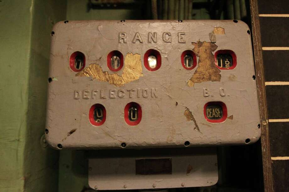 """A part of the fire control system for the guns in the Main Battery Plot which is visited during the """"Hard Hat Tour"""" of the Battleship Texas Friday, Oct. 5, 2012, in La Porte. Photo: James Nielsen, Chronicle / © Houston Chronicle 2012"""