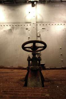 "A valve inside the Battleship Texas in an area visited on the Battleship Texas ""Hard Hat Tour"" Friday, Oct. 5, 2012, in La Porte. Photo: James Nielsen, Chronicle / © Houston Chronicle 2012"