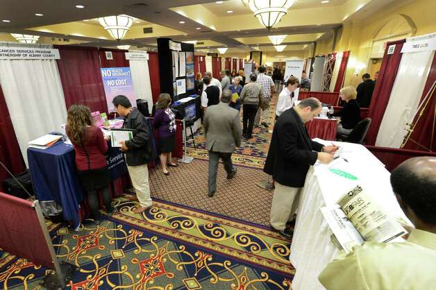 Job seekers attended a job fair which included almost 60 different companies which were looking for workers and was hosted by the Times Union was held at the Marriott Hotel in Colonie, N.Y. Oct. 8, 2012.    (Skip Dickstein/Times Union) Photo: Skip Dickstein