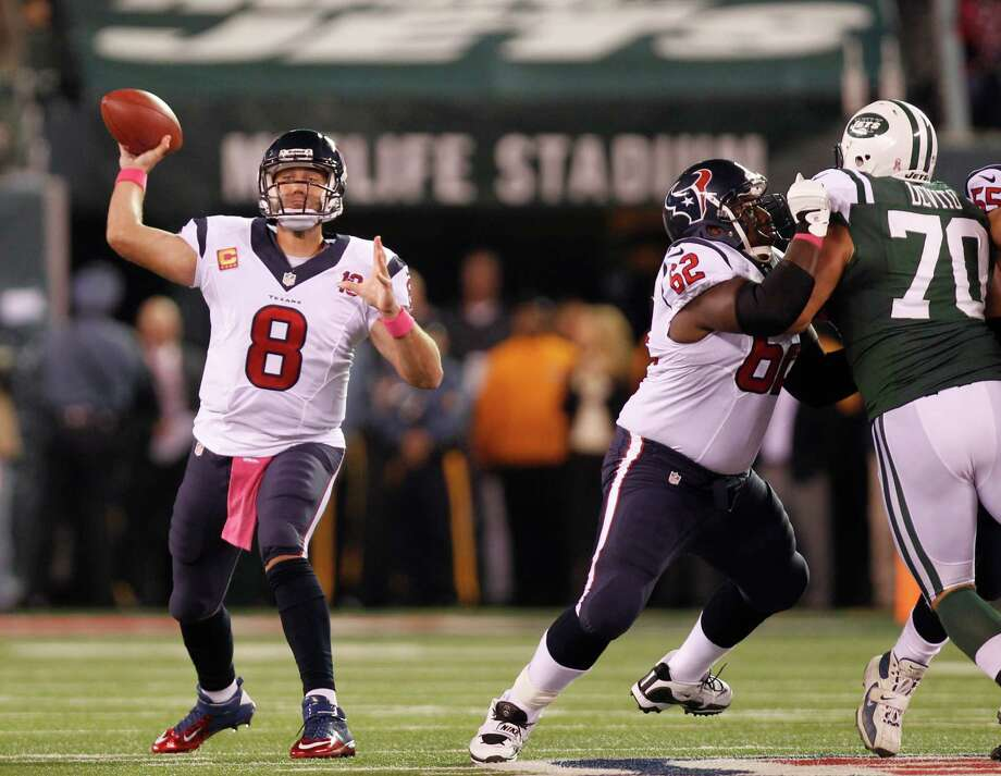 Houston Texans quarterback Matt Schaub (8) gets a block from guard Antoine Caldwell (62) as he fires a pass during the first quarter of a Monday Night Football game against the New York Jets at MetLife Stadium on Tuesday, Oct. 9, 2012, in East Rutherford, N.J. Photo: Smiley N. Pool, Houston Chronicle / © 2012  Houston Chronicle