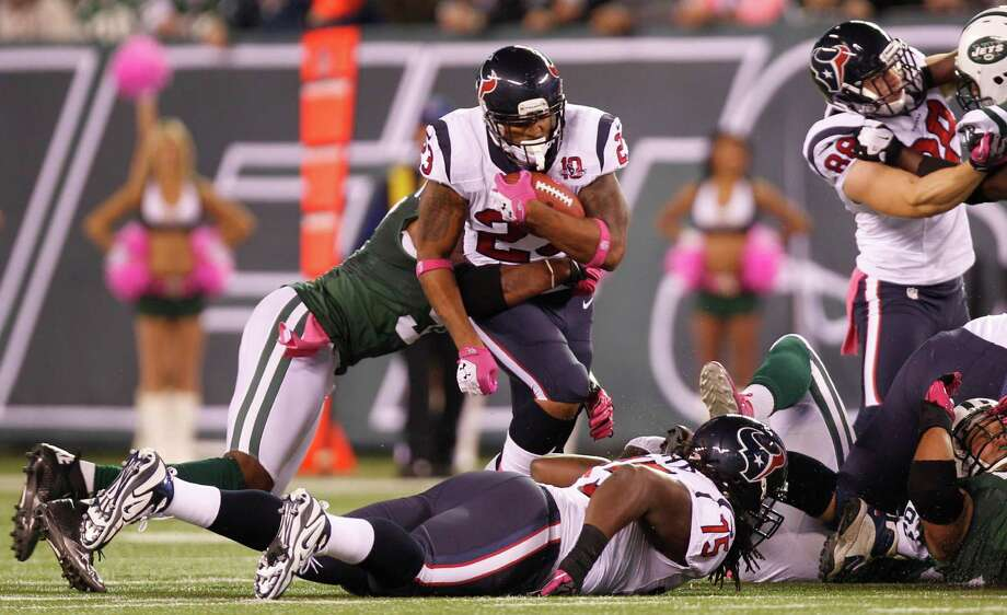 Houston Texans running back Arian Foster (23) is brought down by New York Jets nose tackle Sione Pouha (91) during the first quarter of a Monday Night Football game at MetLife Stadium on Tuesday, Oct. 9, 2012, in East Rutherford, N.J. Photo: Brett Coomer, Houston Chronicle / © 2012  Houston Chronicle