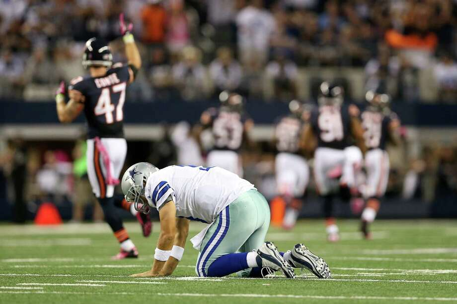 Cowboys quarterback Tony Romo will have to do a better job of securing the football against a ballhawking Ravens defense, which is among the NFL leaders in takeaways, after throwing five interceptions in last week's loss to the Bears. Photo: Ronald Martinez / 2012 Getty Images