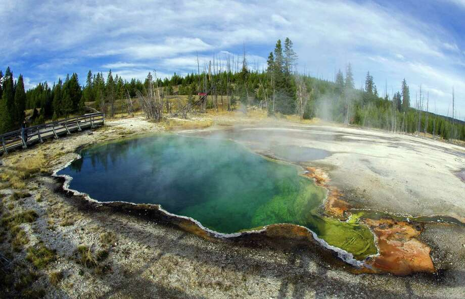 WYOMING: Yellowstone National Park is not just the nation's first national park. It is home to 10,000 geysers, mudpots, steamvents and hot springs. Photo: KAREN BLEIER, AFP/Getty Images / AFP ImageForum
