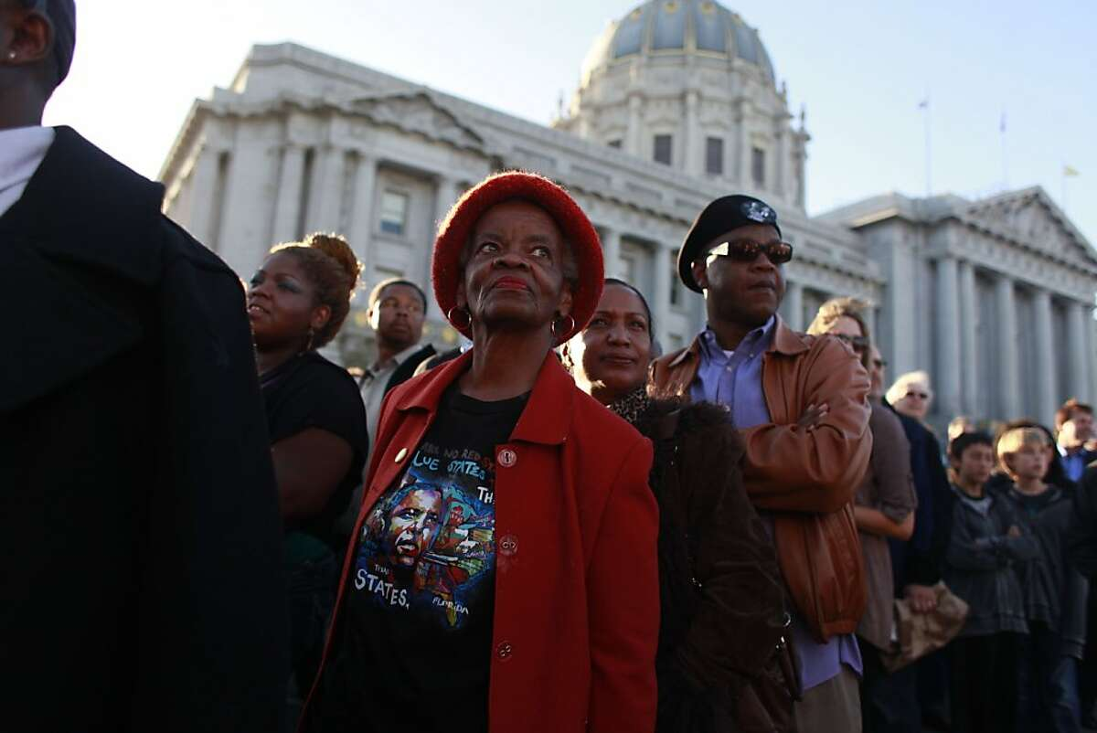 Hilda Robinson, of Oakland, waits for Obama to arrive for a fundraiser at the Bill Graham Civic Auditorium on Monday Oct. 10, 2012 in San Francisco, Calif.