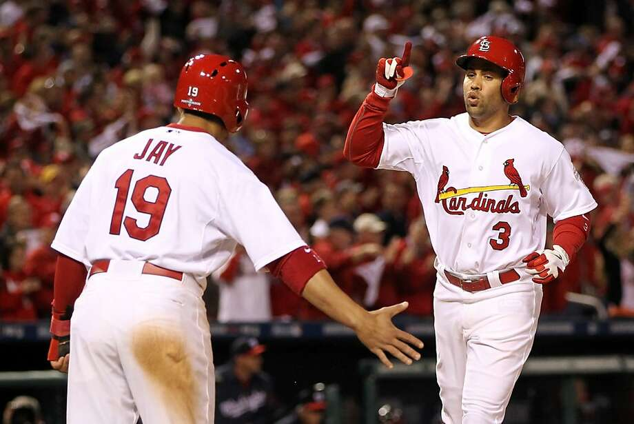 Jon Jay welcomes Carlos Beltran at home after Beltran hit his second homer of the game. Photo: Jamie Squire, Getty Images