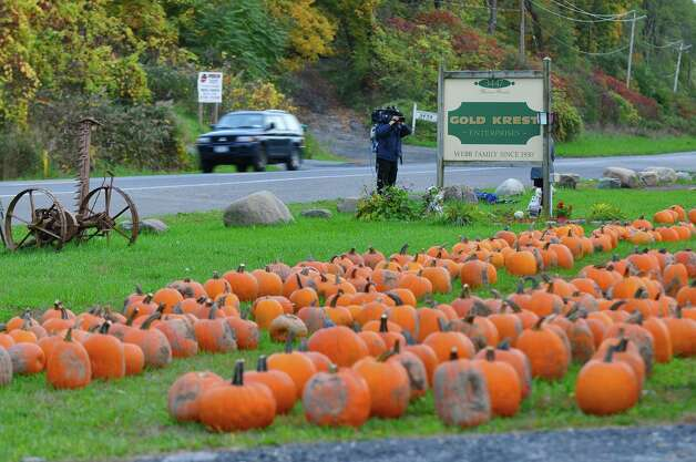 Traffic  on River Road passes in front of Gold Krest Farms on Monday Oct. 8, 2012 in East Greenbush, NY.  Three people were arrested after taking pumpkins from the farms, setting them up as a barricade in the road in front of the farm stand, and watching someone crash into it.   Remnants of the pumpkins are in the road to the left.   (Philip Kamrass /  Times Union) Photo: Philip Kamrass / 10019576A