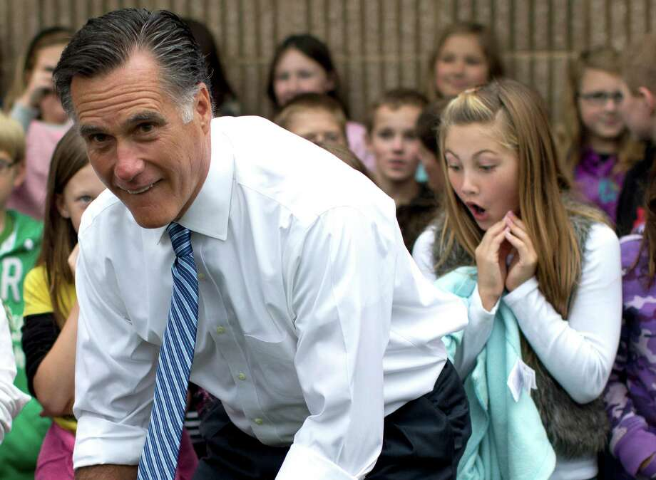 Republican presidential candidate, former Massachusetts Gov. Mitt Romney poses for photographs with students of Fairfield Elementary School, Monday, Oct. 8, 2012, in Fairfield, Va.  (AP Photo/ Evan Vucci) Photo: Evan Vucci / AP