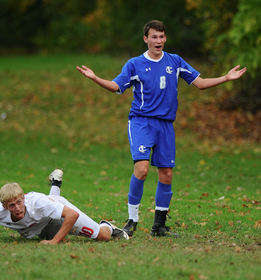 Ichabod Crane's Seth Scarano, right, looks for a call  during their 5-0 victory over Maple Hill on Monday Oct. 8, 2012 in Schodack, NY.  Maple Hill's Jake Johnson is at left. (Philip Kamrass /  Times Union) Photo: Philip Kamrass / 00019563A