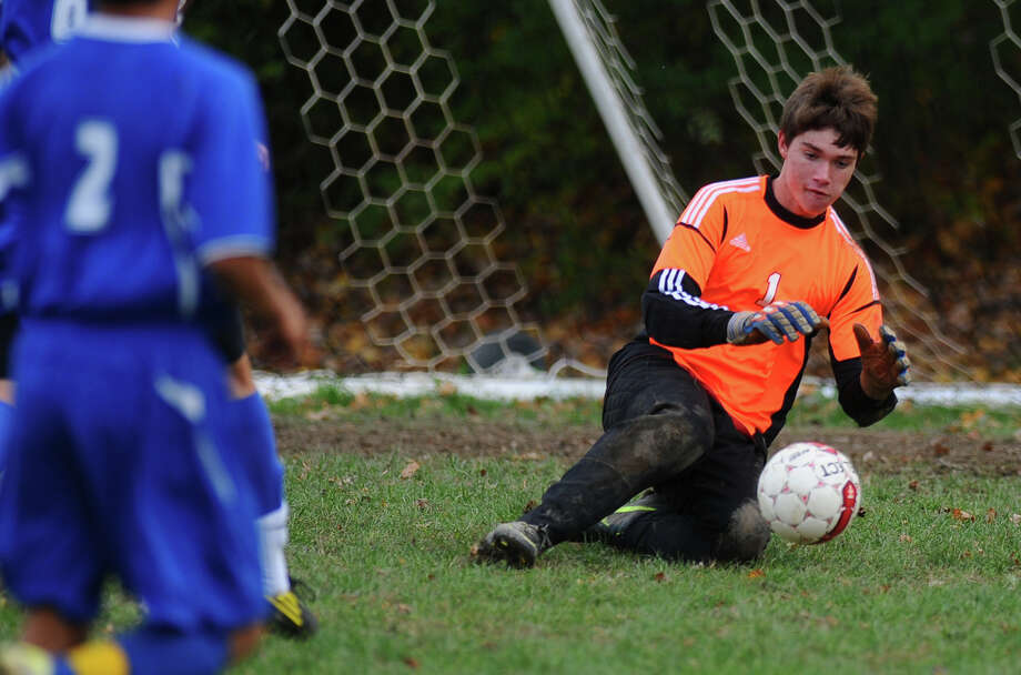 Maple Hill goalie Tom Miller stops a shot during their 5-0 loss to Ichabod Crane on Monday Oct. 8, 2012 in Schodack, NY.  (Philip Kamrass /  Times Union) Photo: Philip Kamrass / 00019563A