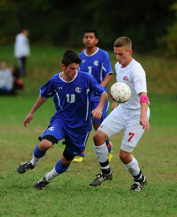 Maple Hill's Jesse Moore, right, battles Ichabod Crane's Mihai Vlad, left,  during their 5-0 loss to Ichabod Crane on Monday Oct. 8, 2012 in Schodack, NY.  (Philip Kamrass /  Times Union) Photo: Philip Kamrass / 00019563A