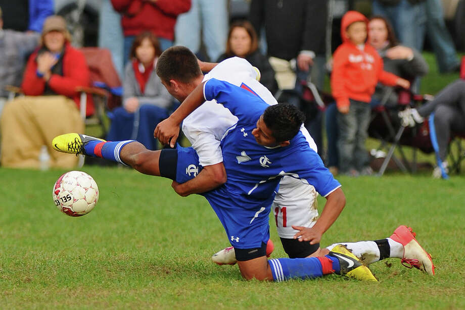 Ichabod Crane's Eduardo Gomez, right, battles Maple Hill's Logan Samarija, left, during their 5-0 victory over Maple Hill on Monday Oct. 8, 2012 in Schodack, NY.   (Philip Kamrass /  Times Union) Photo: Philip Kamrass / 00019563A