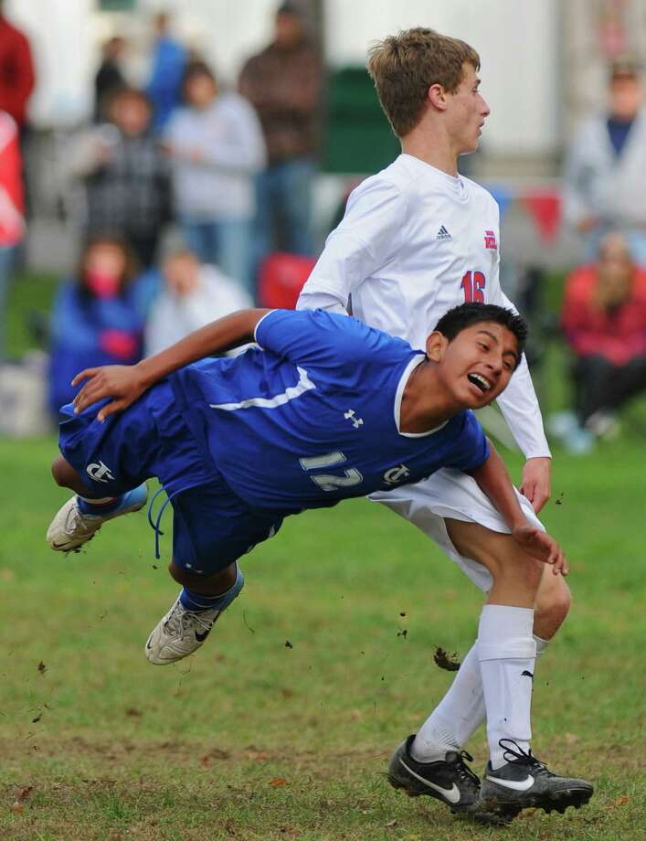 Ichabod Crane's Heriberto Gomez, left, collides Maple Hill's Nick Kern, right,  during their 5-0 victory over Maple Hill on Monday Oct. 8, 2012 in Schodack, NY.   (Philip Kamrass /  Times Union) Photo: Philip Kamrass / 00019563A