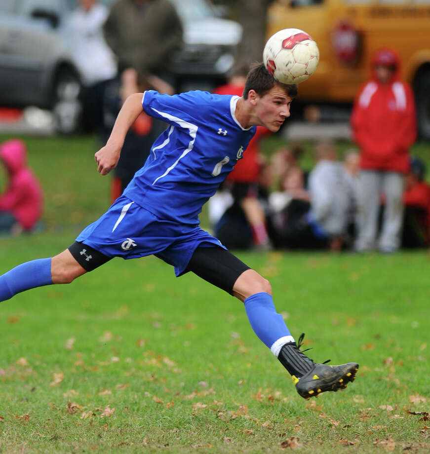 Ichabod Crane's Seth Scarano scores a goal during their 5-0 victory over Maple Hill on Monday Oct. 8, 2012 in Schodack, NY.   (Philip Kamrass /  Times Union) Photo: Philip Kamrass / 00019563A