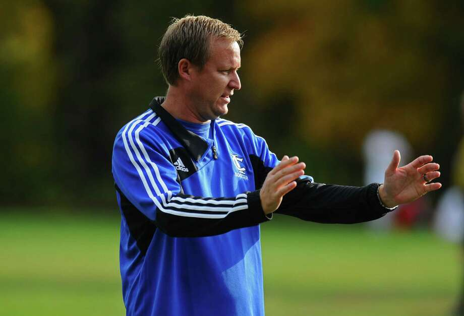 Ichabod Crane boys soccer team coach Mattias Nordgren talks to his team during halftime of their 5-0 victory over Maple Hill on Monday Oct. 8, 2012 in Schodack, NY.   (Philip Kamrass /  Times Union) Photo: Philip Kamrass / 00019563A