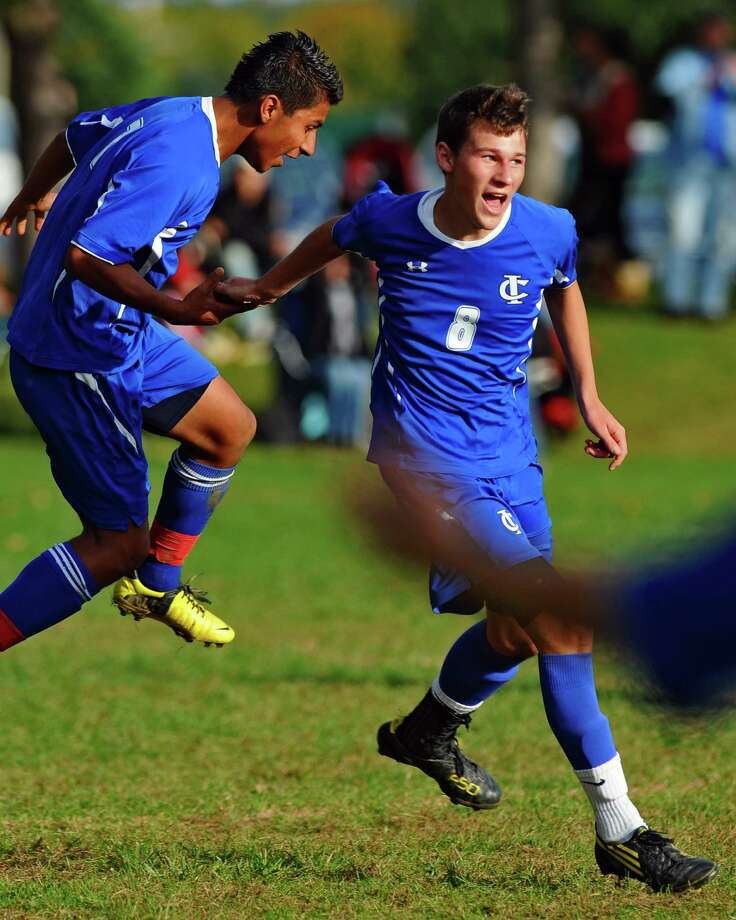 Ichabod Crane Seth Scarano, right, celebrates after scoring a goal, with teammate Eduardo Gomez, left,  during their 5-0 victory over Maple Hill on Monday Oct. 8, 2012 in Schodack, NY.   (Philip Kamrass /  Times Union) Photo: Philip Kamrass / 00019563A