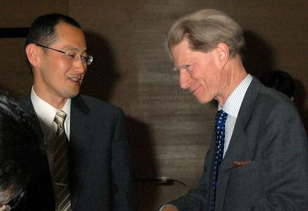 In this April, 2008 photo, Kyoto University Professor Shinya Yamanaka, left, and British researcher John Gurdon exchange words as they attend a symposium on induced pluripotent stem cell in Tokyo.  Gurdon and Yamanaka of Japan won this year's Nobel Prize in physiology or medicine on Monday, Oct. 8, 2012 for discovering that mature, specialized cells of the body can be reprogrammed into stem cells - a discovery that scientists hope to turn into new treatments. (AP Photo/Kyodo News) JAPAN OUT, MANDATORY CREDIT, NO LICENSING IN CHINA, FRANCE, HONG KONG, JAPAN AND SOUTH KOREA Photo: Associated Press