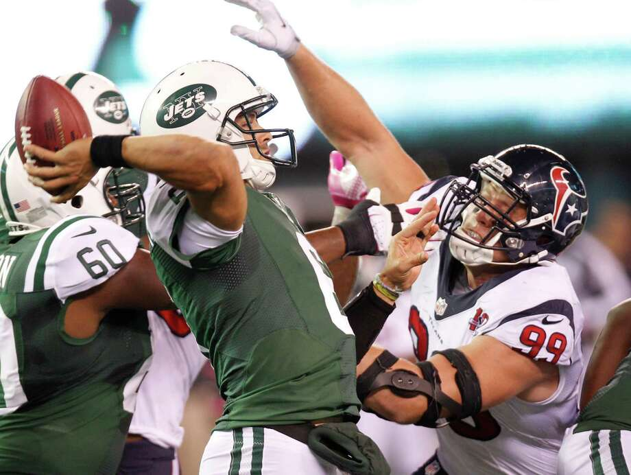 New York Jets quarterback Mark Sanchez (6) gets off a pass as Houston Texans defensive end J.J. Watt (99) applies pressure during the second quarter of a Monday Night Football game at MetLife Stadium on Monday, Oct. 8, 2012, in East Rutherford, N.J. Photo: Brett Coomer, Houston Chronicle / © 2012  Houston Chronicle