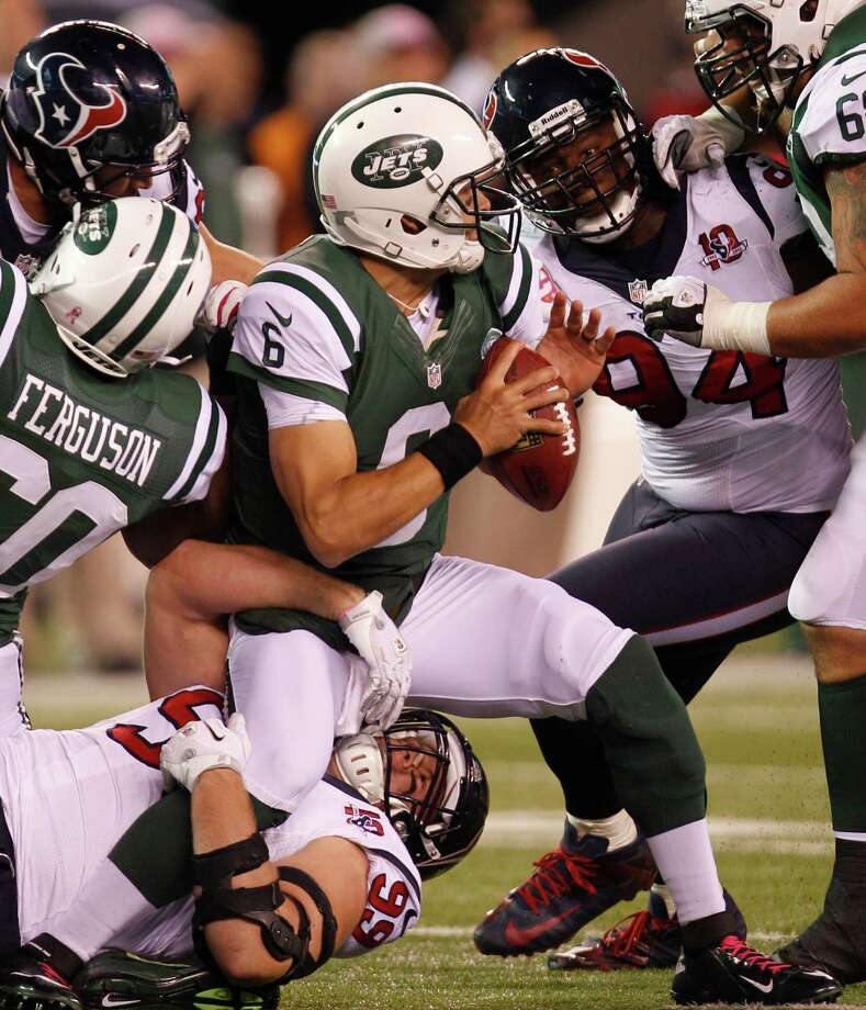 New York Jets quarterback Mark Sanchez (6) tries to get off a pass as he is tackled by Houston Texans defensive end J.J. Watt (99) during the second quarter of a Monday Night Football game at MetLife Stadium on Monday, Oct. 8, 2012, in East Rutherford, N.J. Photo: Brett Coomer, Houston Chronicle / © 2012  Houston Chronicle
