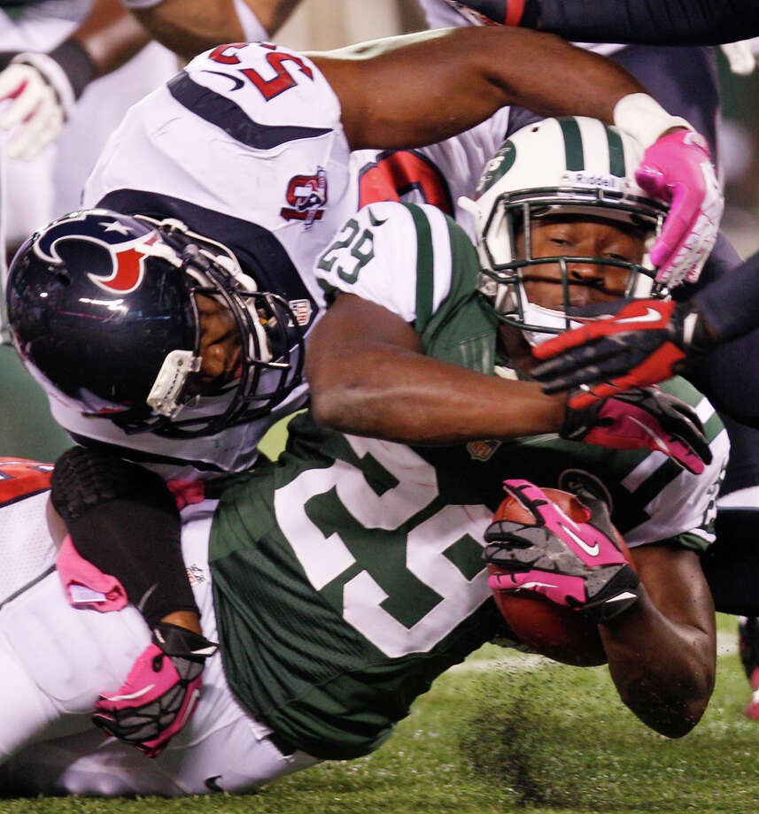 New York Jets running back Bilal Powell (29) is brought down by Houston Texans inside linebacker Bradie James (53) during the second quarter of a Monday Night Football game at MetLife Stadium on Monday, Oct. 8, 2012, in East Rutherford, N.J. Photo: Brett Coomer, Houston Chronicle / © 2012  Houston Chronicle