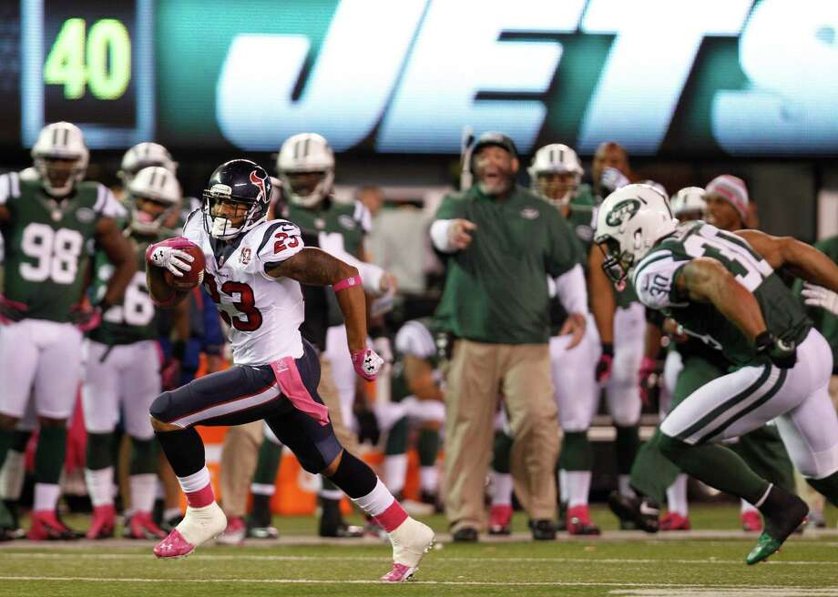 Houston Texans running back Arian Foster (23) breaks away from New York Jets free safety LaRon Landry (30) during the second quarter of a Monday Night Football game at MetLife Stadium on Monday, Oct. 8, in East Rutherford, N.J. Photo: Brett Coomer, Houston Chronicle / © 2012  Houston Chronicle