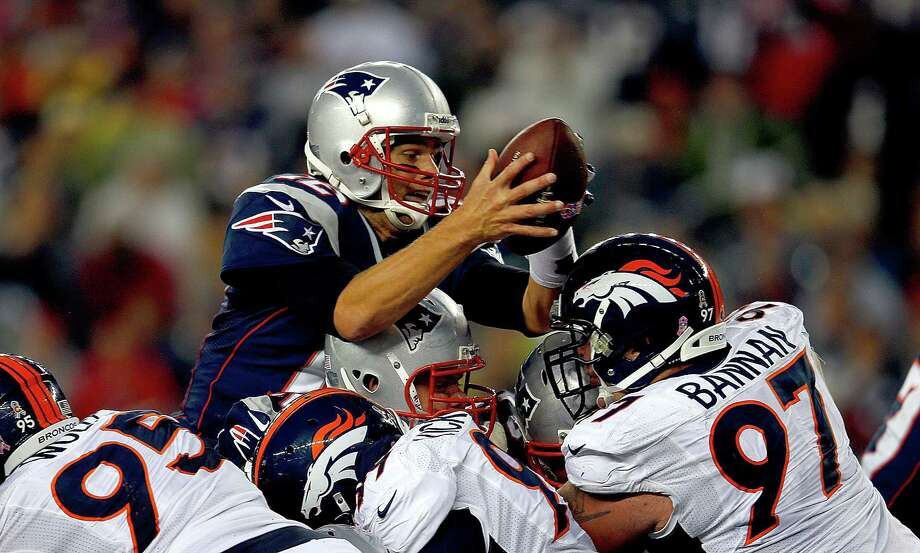 FOXBORO, MA - OCTOBER 7:   Tom Brady #12 of the New England Patriots leaps in for a touchdown in the third quarter during a game with the New England Patriots at Gillette Stadium on October 7, 2012 in Foxboro, Massachusetts. (Photo by Jim Rogash/Getty Images) Photo: Jim Rogash